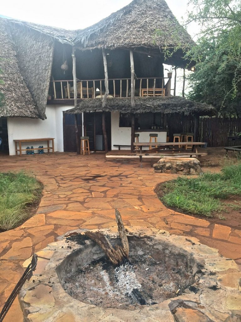 The kitchen area of the house in the backdrop of the fire pit